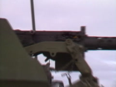 Military, soldier cocking .50 cal heavy machine gun profile ECU Stock Footage