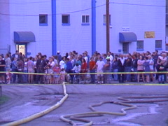 Fire, Seed mill fire, #4 crowds behind police/fire lines Stock Footage