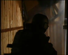 SWAT / Special Forces running through attic Stock Footage