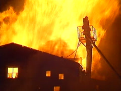 Stock Video Footage of fire, Seed mill fire, #8 flames roar through roof, massive dramatic fire!