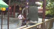 Stock Video Footage of Lama temple, man beats gong
