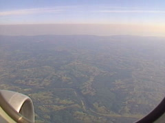Aerial smoggy European sky in flight Stock Footage