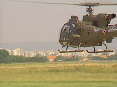 Military Aérospatiale Gazelle Helicopter hover  Stock Footage