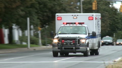 Emergency vehicle races by - stock footage