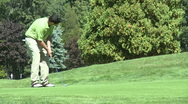 Stock Video Footage of Amateur golfer putting (2 of 3)