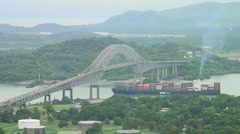 Panama Canal: Ship passes under Bridge of the Americas Stock Footage