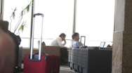 Stock Video Footage of Executives in Airport Lounge