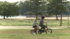 Children riding bikes (2 of 3) - stock footage