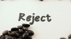 Stock Video Footage of reject.  written on white under coffee