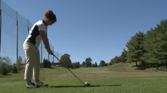 Female golfer drives the ball Stock Footage