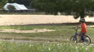 Stock Video Footage of Children riding bikes (1 of 3)