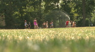 Stock Video Footage of Kids play in a sprinkler