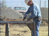Stock Video Footage of MEN WORKING ON REBAR