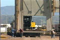 CRANE MOVES GIANT WALL Stock Footage