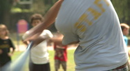 Stock Video Footage of Kids play wiffle ball (2 of 3)