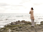 Alone woman standing on the seashore Stock Footage