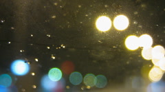 Night city traffic through wet window time lapse Stock Footage