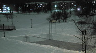 Stock Video Footage of man removing snow from the ice rink time lapse