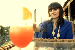 Beautiful summer girl having a cocktail drink  Stock Footage