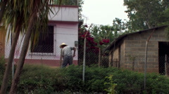 Man hoeing Guatemala village Stock Footage