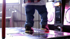 Feet moving on Dancing Arcade mat - stock footage
