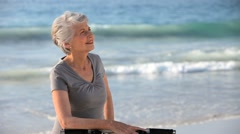 Aged woman waiting with a bike Stock Footage