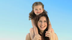 Smiling woman carrying her daughter on her shoulders Stock Footage
