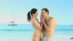Couple listening to a seashell Stock Footage