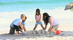 Family building a sand castle Stock Footage