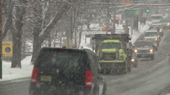 Snow plowing truck in traffic under a snow storm-Liberta0035 Stock Footage