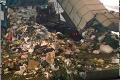 GARBAGE TRUCKS DUMP LOAD - stock footage