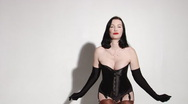 Stock Video Footage of Beautiful pinup girl in black corset dancing
