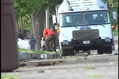CURBSIDE GARBAGE COLLECTION Stock Footage