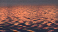 Sunset reflex on lake mid1 Stock Footage