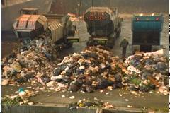 GARBAGE TRUCKS DUMP LOAD 2 - stock footage