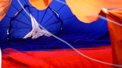 Blow up hot air balloon before competition - stock footage