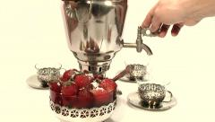 Hot water is poured from a samovar Stock Footage
