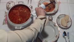 Chef pours the soup into bowls Stock Footage