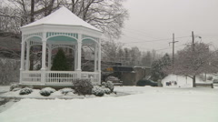 Train and bandstand under a snow storm-Liberta0038 Stock Footage
