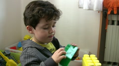 Little Boy playing toys Stock Footage