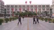 Chinese workers in China Donguan Shoe Factory - main building workers passing by Stock Footage