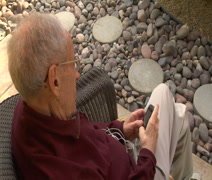 Older man ends call on cell phone Stock Footage