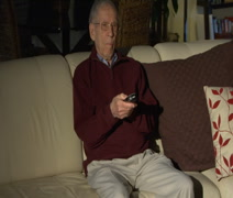 Elderly man changing tv channels  with remote control Stock Footage