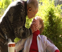 Elderly older couple morning kiss Stock Footage