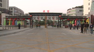 Chinese workers in China Donguan Shoe Factory - factory entrance wide shot Stock Footage