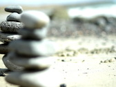 Stock Video Footage of Zen stones on a beach, dolly shot