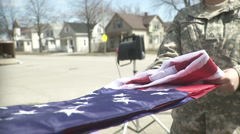 Unfolding the American Flag by the Military (slow motion) Stock Footage