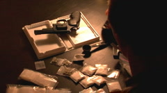 Drug Dealer Preparing Drugs with Weapon - stock footage