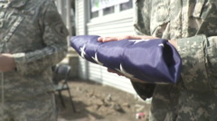 Soldiers unfolding the American Flag (slow motion) Stock Footage
