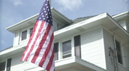 American Flag being raised high Stock Footage